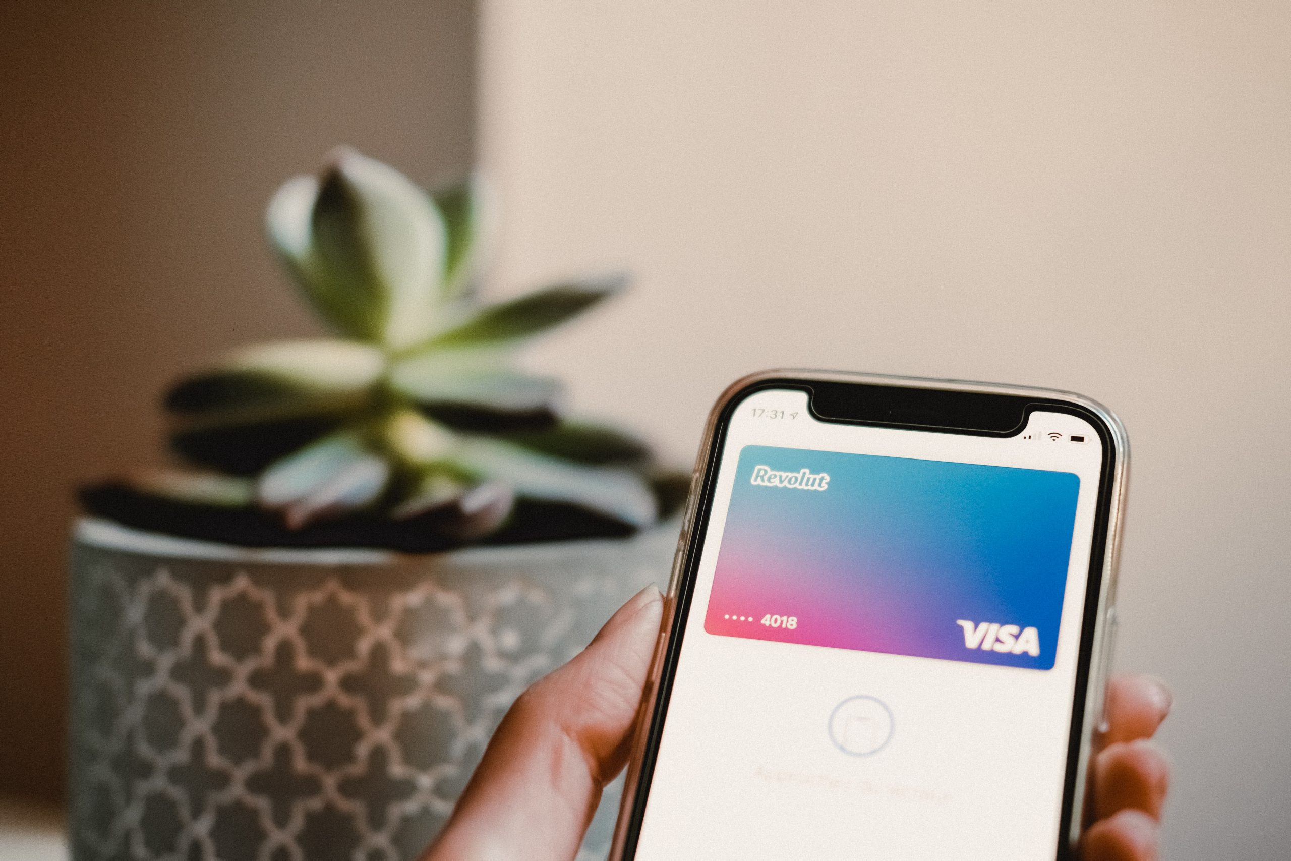 hand holding mobile phone with revolut app open